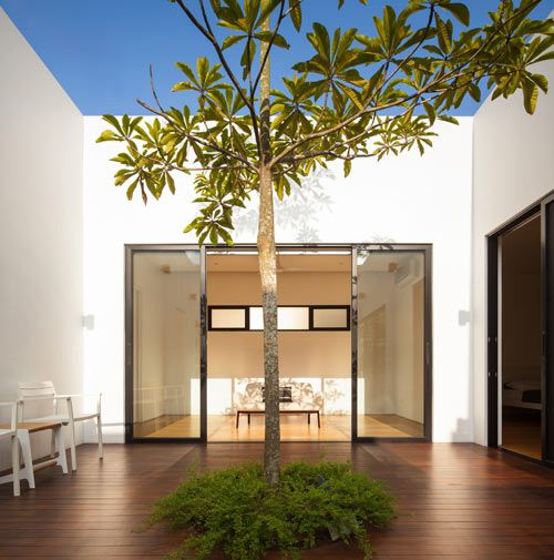 With little bits of roof, I would love to sit on the side and watch the rain fall in the middle. Mandai Courtyard House by Atelier M + A