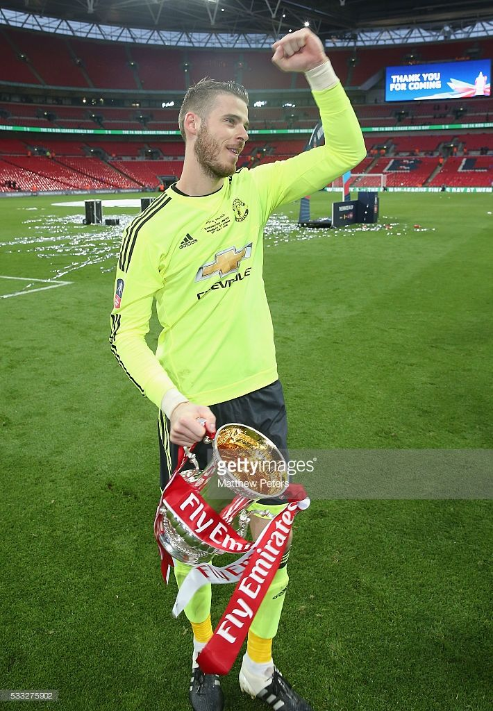 David de Gea of Manchester United celebrates with the FA Cup trophy after The Emirates FA Cup final match between Manchester United and Crystal Palace at Wembley Stadium on May 21, 2016 in London, England.