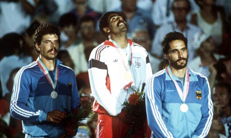 The decathlete Daley Thompson stands atop the podium with his gold medal in 1984