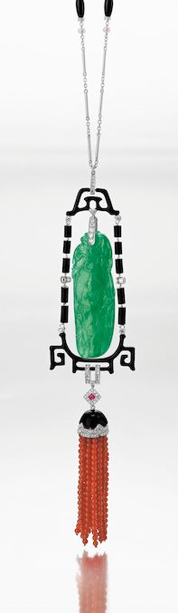 ART DECO JADEITE PENDANT NECKLACE CIRCA. 1925, green jadeite of fine translucency, carved with bats and foliage, surrounded by a stylised chinoiserie border of onyx beads interspersed by brilliant-cut diamonds, suspending coral bead tassels surmounted by an onyx-set cap decorated with circular-cut diamonds, mounted in platinum.