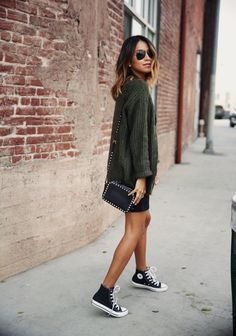 Le Fashion Blog Ways To Wear Black High Top Converse Sneakers Green Knit Sweater Stud Crossbody Bag Via Sincerely Jules