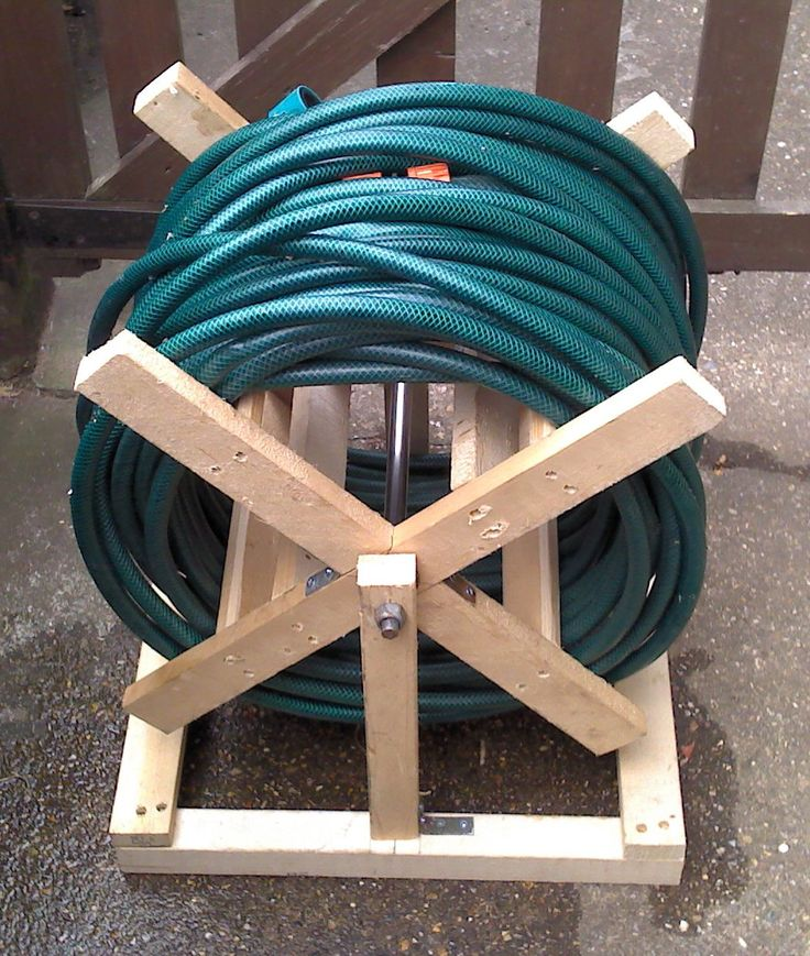 25 best ideas about hose reel on pinterest garden hose for Diy garden hose storage