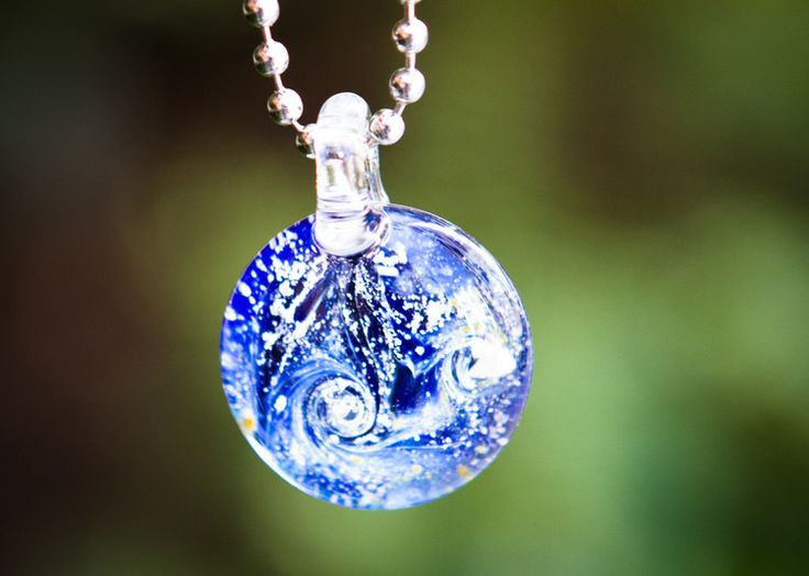 Glass cremation necklace jewelry incorporates a small amount of cremated ash directly into the glass pendant. The flat disk is .75 inch wide. A wonderful example of cremation jewelry. This lovely bubb