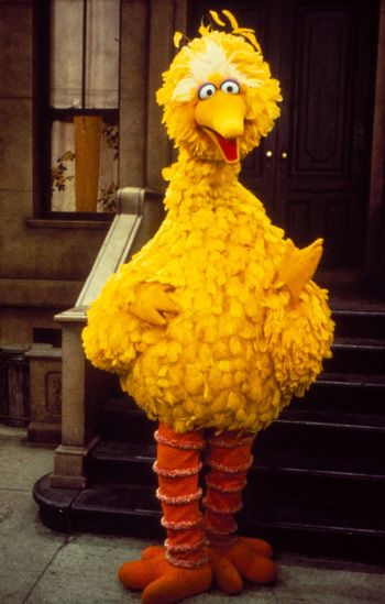 Big Bird working on voice of Caroll Spinney of Oscar the Grouch