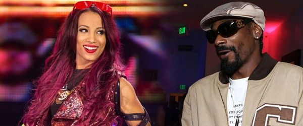 Snoop Dogg: America Can't Have a 'Reckless Motherf*cker' Like Trump Running the Country. Pictured here with his cousin Sasha Banks of WWE.