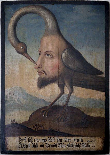 """This painting (oil on wood) from the last third of the 17th century alludes to the popular proverb """"Nimm dich selbst bei der Nase"""" (""""take yourself by your nose""""). It's also called """"Vogel Selbsterkenntnis"""" (Bird of self-knowledge) and exists in several samples (three, at least, in that same museum)."""