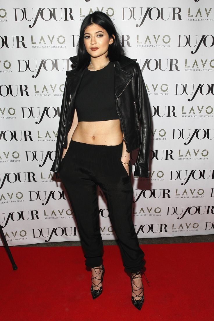 At a party in her honor alongside Kendall, Jenner is totally edgy in a black-on-black, wearing a crop top, leather jacket worn on the shoulders, slouchy trousers, and lace-up heels.   - MarieClaire.com