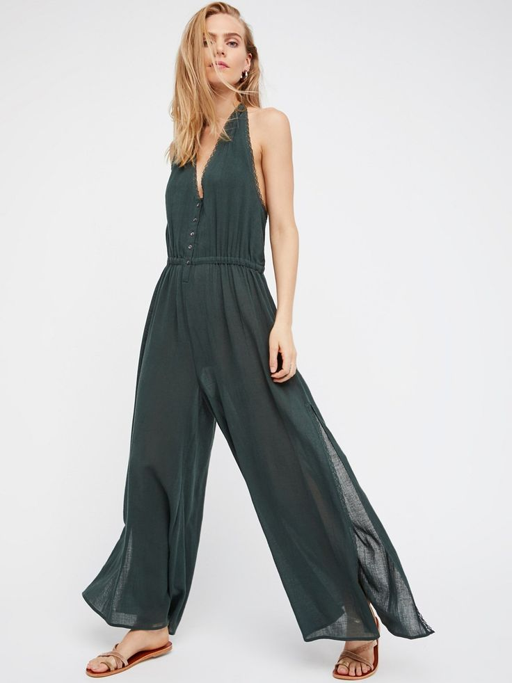 On The Run Jumpsuit | Racerback jumpsuit inspired by decades past featuring front button closures and a relaxed fit through the leg.    * Lined