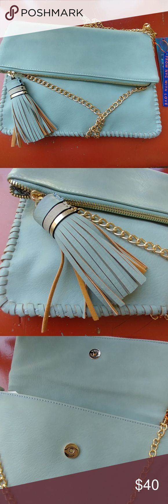 Tiffany blue crossbody bag Tassels,  golden  hardware,  makes this amazing bag perfect for spring.  Chain is removable, so you can wear it as clutch for a more put together look.  Vegan Made in USA  11 WIDE 9 HIGHT  SHOULDER DOWN 22 INCHES Bags Crossbody Bags