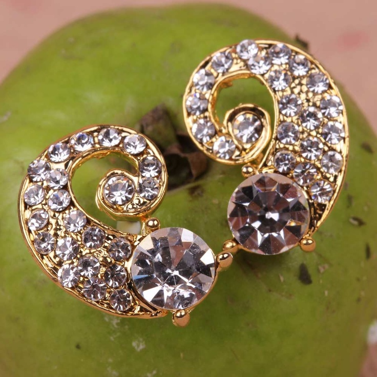 Curvy Diamond Crystal Earrings are uniquely designed that you would love to flaunt. These earrings come in a diamond pattern offering it a very alluring look. So, what are you waiting for, grab them now      Fashion Statement      Wear these earrings with designer saris and suits.