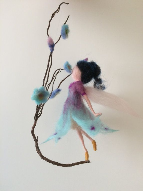 This air, flying creation decorate any corner of the house. Made of wool in two colors: purple and turquoiseю The height of about 15 cm. Decor: natural twig