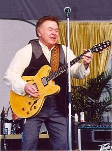 Roy Clark ~ An American country music musician and performer. He is best known for hosting Hee Haw, a nationally televised country variety show. Clark has been an important and influential figure in country music, both as a performer and helping to popularize the genre. Most of all, he is an entertainer, with an amiable personality and a telegenic presence. Clark is highly regarded as a guitarist and banjo player, and is also skilled in classical guitar and several other instruments.