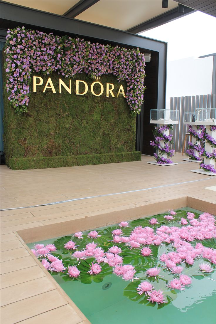Beautiful flower wall and styling produced and designed by Carousel Events Dubai, for Pandora launch of spring 2016 new collection.