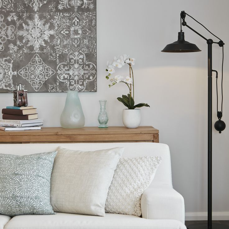 #wallart #lamp #cream #naturaltimber #lamp #loungeroom #livingarea #cushions #styling #bellriverhomes #sideboard
