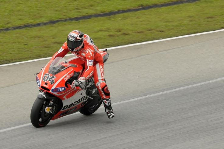Andrea Dovizioso tries out his Ducati Desmosedici GP13 during the second Sepang Test