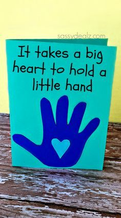"""Have your kids make this easy handprint Father's Day card for dad! It says """"It takes a big heart to hold a little hand"""" with a handprint underneath."""