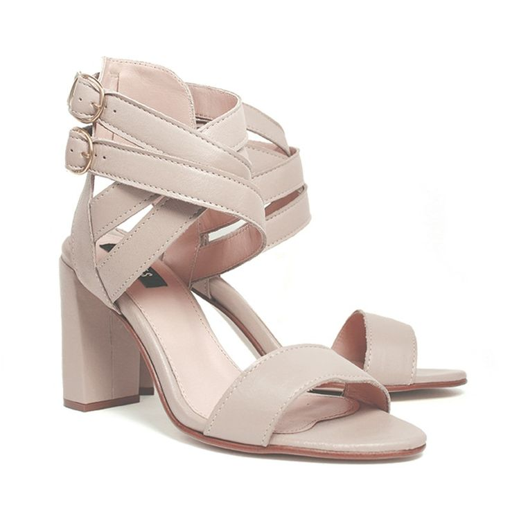 High heel sandals in nude leather with ankle straps.