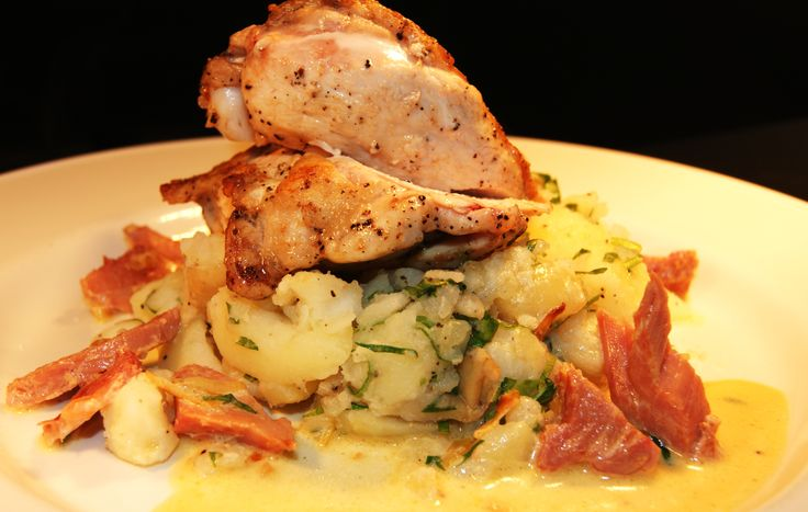 French trimmed chicken on crushed potatoes with a ham and leek white wine sauce