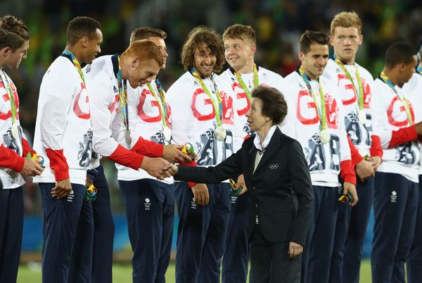 Princess Anne Photos - HRH Princess Anne, Princess Royal shakes hadns with silver medalists Great Britain during the medal ceremony for the Men's Rugby Sevens on Day 6 of the Rio 2016 Olympics at Deodoro Stadium on August 11, 2016 in Rio de Janeiro, Brazil. - Rugby - Olympics: Day 6