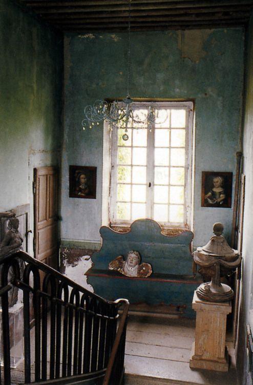 black railings, wood floor, old paper/ paint