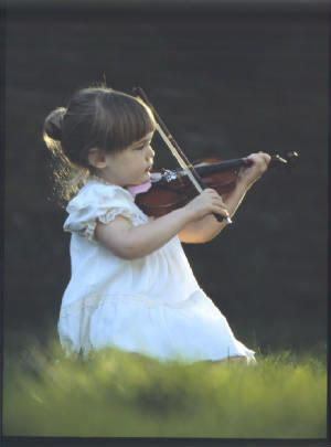 This child can play the violin. I cant even sing in tune. i admire that.