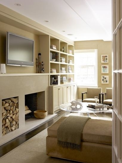 This neutral room gives you a warm earthy feeling. Its warm rich browns and tans create a cozy but still interesting. The texture next to the fire place was a nice addition to the room. Overall this room is very interesting but still has all of the qualities of a neutral color scheme.