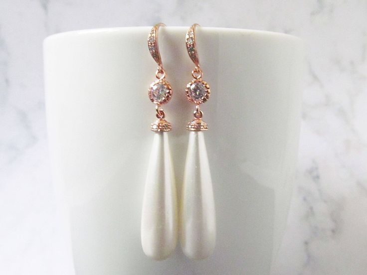 Rose gold teardrop earrings that are perfect statement earrings for your wedding or special occasion, these made with a shell teardrop pearl and a luxurious cubic zircon encrusted hook. A gorgeous earring made in a vintage style.