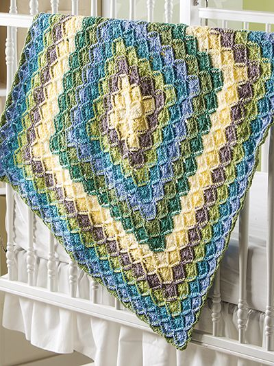 Free Crochet Pattern Download -- This Bavarian Baby Blanket, designed by Jenny King, is featured in episode 4, season 5 of Knit and Crochet Now! TV. Learn more here: https://www.anniescatalog.com/knitandcrochetnow/patterns/detail.html?pattern_id=17&series=2