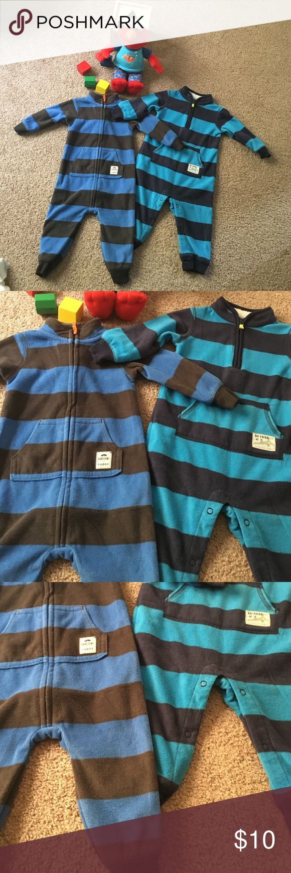 Bundle of 2 Carter's Fleece Bodysuits 2 fleece body suits, Carter's brand, size 9M, very gently used, royal blue/grey is complete zip closure, navy & sky blue is zip neck with button closure at legs. Both are footless, perfect to wear with cute shoes or boots on a cold day! Excellent condition! Carter's One Pieces Bodysuits