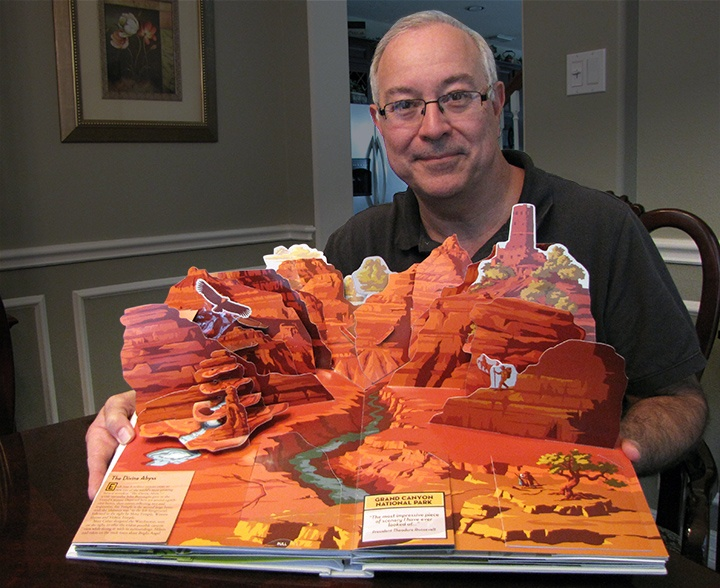 Bruce Foster showing his most recent pop-up book: America's National Parks