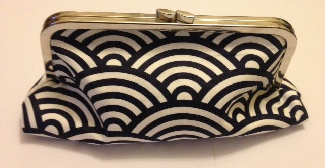 A stunning Japanese wave pattern clutch bag, lined in brilliant red. It's $45.02
