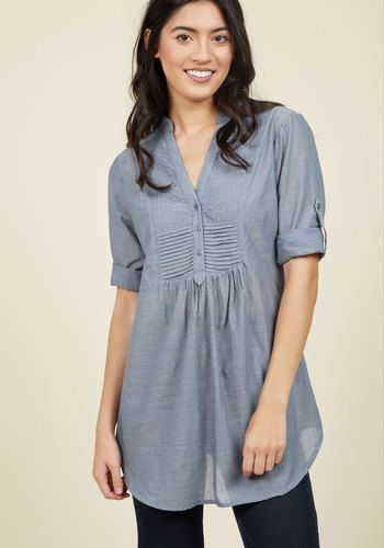 You always look forward to a weekend drive in the country, and when you spy the soft chambray of this stream-blue top, you know it's the perfect piece to wear on a sun-filled afternoon. Featuring a buttoned, pin-tucked bodice, tabbed rolled sleeves, and a collarless silhouette, this tunic-length top will clothe you in comfort on the winding roads.