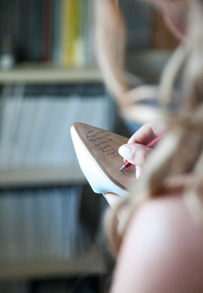 Writing the bridesmaids names on the bridal shoe's sole, the one whose name is rubbed off is going to get married next- Mitheo Events | Concept Events Styling