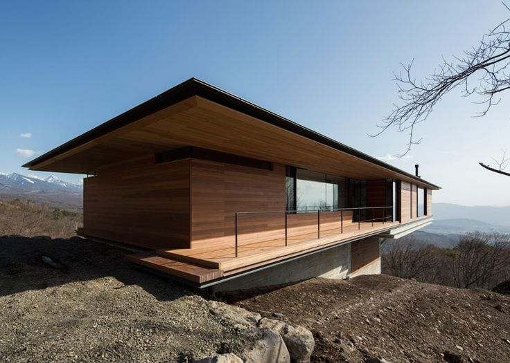 Mountainside home by Kidosaki Architects extends out into the sky.