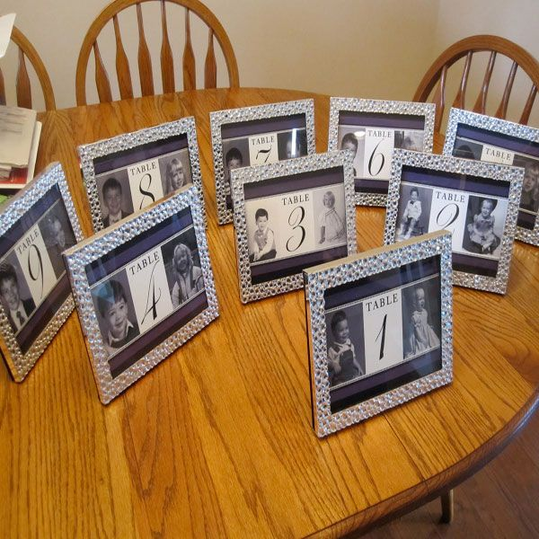 Table numbers with pictures of the bride and groom at that age.