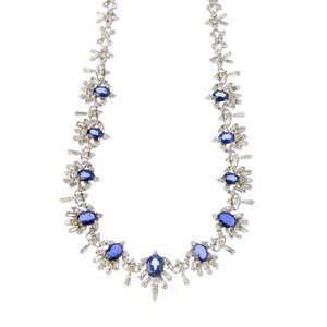LOT:85   A sapphire and diamond necklace.