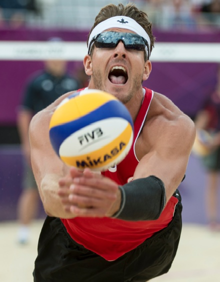 Martin Reader dives for a ball during preliminary beach volleyball action againt Great Britain at the 2012 London Olympic Games