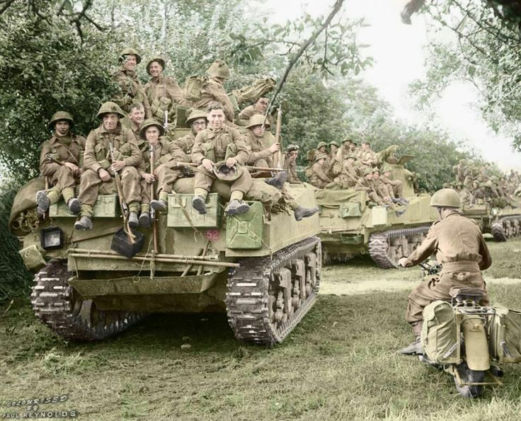 """British Sherman tanks of the Staffordshire Yeomanry, 27th Armoured Brigade, carrying infantry from the 3rd Division, move up at the start of Operation """"Goodwood"""", 18th July 1944. #ww2 #history #america #military #panzer #war #historical #werhmacht #army #axis #thirdreich #worldwartwo #worldwar #worldwar2 #wwii #ww2germany #soldier #tanks #tank #usarmy #britisharmy #soldiers #british #uk🇬🇧 #uk #gun #guns"""