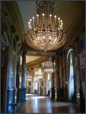 Overly big chandeliers generously decorated with crystals add to the festive ambiance in Austria's most prestigious theater, the Burgtheater. - Susie B., - Burgtheater, Vienna, via Flickr.
