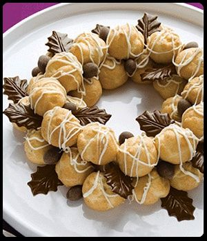 Cake Recipe | Kuchen Rezepte | Arrange 24 mini puffs in a wreath shape on serving platter (10 puffs in inner ring and 14 puffs in outer ring). Drizzle puffs generously with white chocolate. Arrange remaining 12 puffs over top of ring. Drizzle with additional white chocolate. Decorate and serve. Garnish Ideas DCD Chocolate Leaves, DCD Chocolate and Cinnamon Dusted Almonds