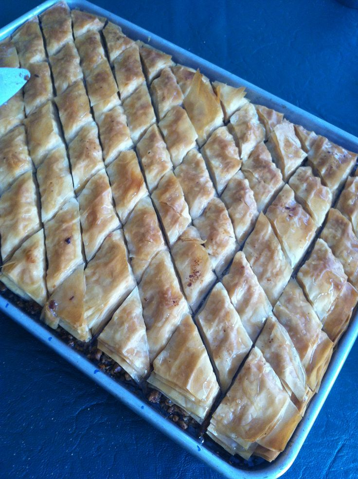 Look what my dad just made, baklava! Tomorrow is Eid, which is like our Christmas expect there is no tree or presents. But nevertheless it's a celebration with family/friends and it's fun and there is lots of food! :)