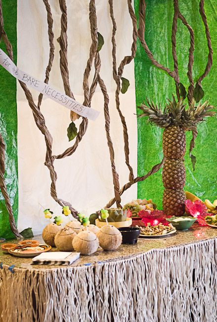 WOW! This jungle themed party is amazing! How to make a pineapple palm tree, DIY table skirt, DIY tree vines, jungle themed food and more! via @Kendra Henseler Henseler Halterman #JungleFresh #shop