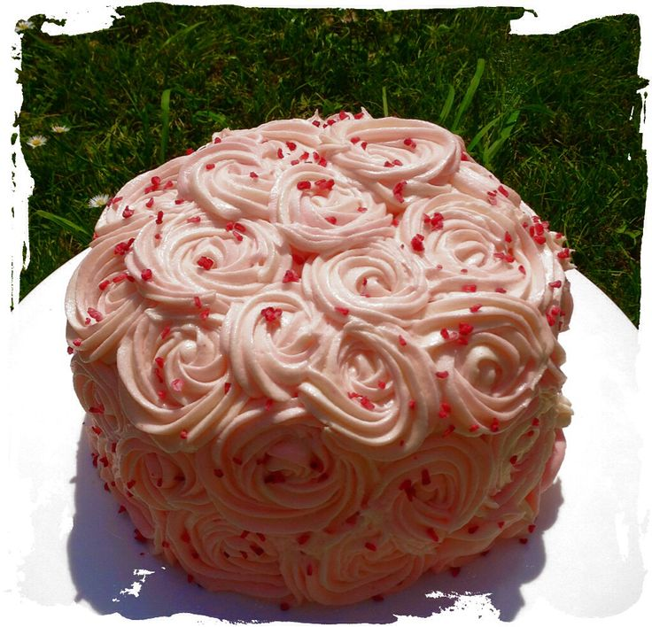 Neopolitan marble cake filled with cream and berries, finished with buttercream swirls.