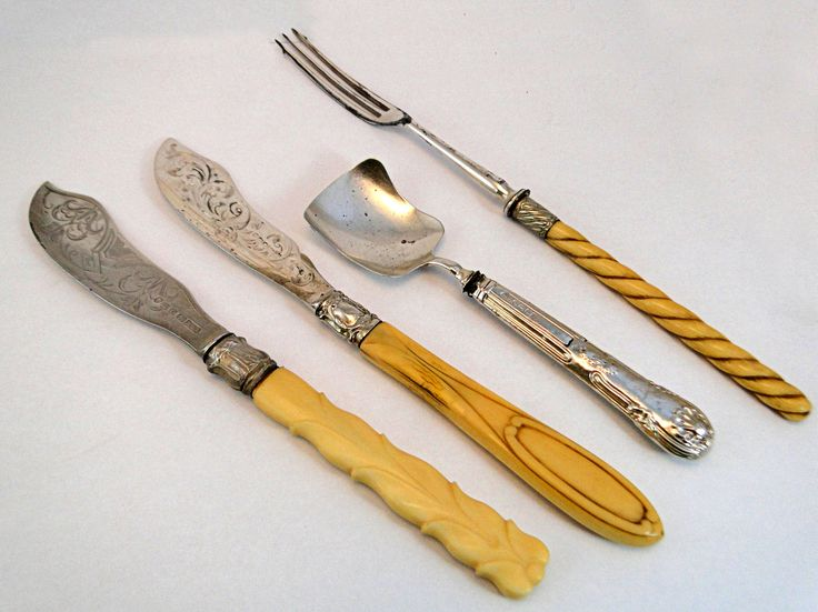 301) Two Victorian silver carved bone handle butter knives, a silver handle sugar shovel and a carved bone handle pickle fork (4) Est. £20-£30