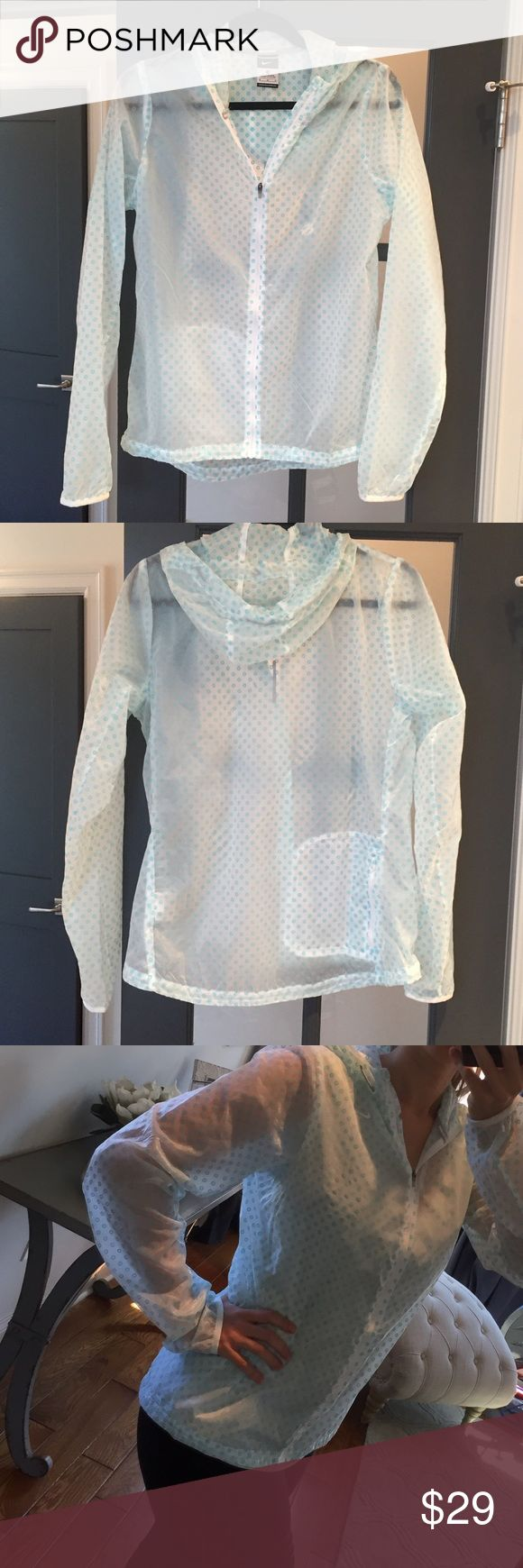 Nike running jacket Never worn! New without tags. Clear Nike running jacket with small blue circles. Circles are slightly raised and soft to the tough. Has drawstring hood and reflective stripe on back. No trades! Make an offer! Nike Jackets & Coats