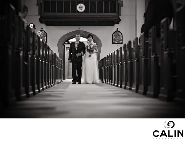 Photography by Calin - Holy Rosary Church Wedding Photographer:  This is an candid environmental portrait of the bride and her father at Holy Rosary Church in Toronto. For a Toronto wedding photographer, the processional is one of the most important parts of the wedding when everything has to go perfect from a photographic standpoint. Every bride requests a perfect photo of her walking down the aisle accompanied by her father.&nbsp,  Best Holy Rosary Wedding Photography:  As a Toronto…