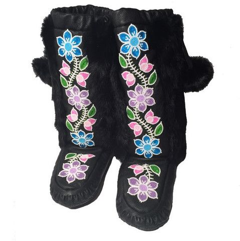 Rosa Scribe was born in the Cree community of Norway House, Manitoba. Rosa is a very soft-spoken and inspiration artist. She speaks volumes through her beautiful and colourful work. Having learned the art of mukluk and moccasin making fr...