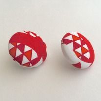 The african fabric earring comes in orange, red and white color, african fabric and silver material.