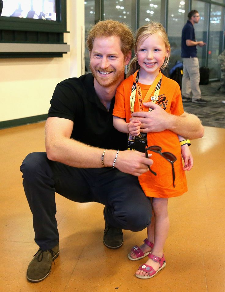 Prince Harry melting hearts as he poses with a Dutch girl named Daimy Gommers at Invictus Games Orlando 2016. (Photo by Chris Jackson/Getty Images)  via @AOL_Lifestyle Read more: http://www.aol.com/article/lifestyle/2016/09/20/couples-in-this-part-of-the-country-are-the-most-likely-to-divor/21475809/?a_dgi=aolshare_pinterest#fullscreen