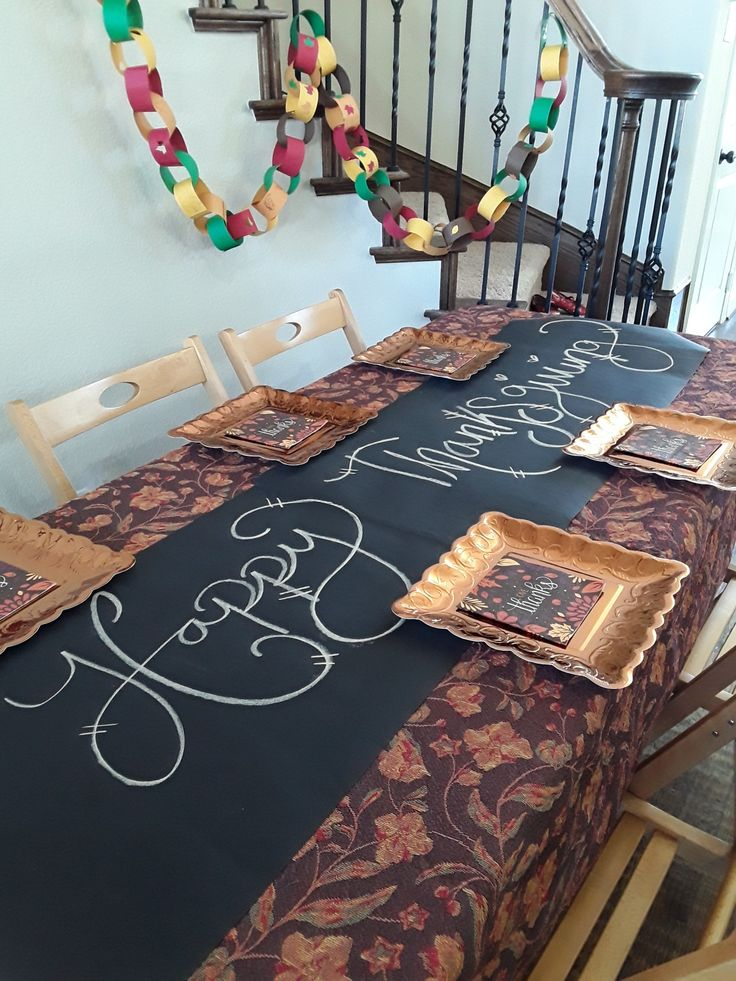 Chalkboard table runner from our bicycle party kit, repurposed for Thanksgiving kids table. Great waynto fend them off and keep them busy while food is being prepared and served. Ours were mostly too little, but would be a fun way to share what your thankful for, maybe next year. #Thanksgivingtable #thanksgivingkidstable #chalkboardtablerunner